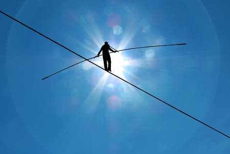 46326026-tightrope-walker-balancing-on-the-rope-concept-of-risk-taking-and-challenge